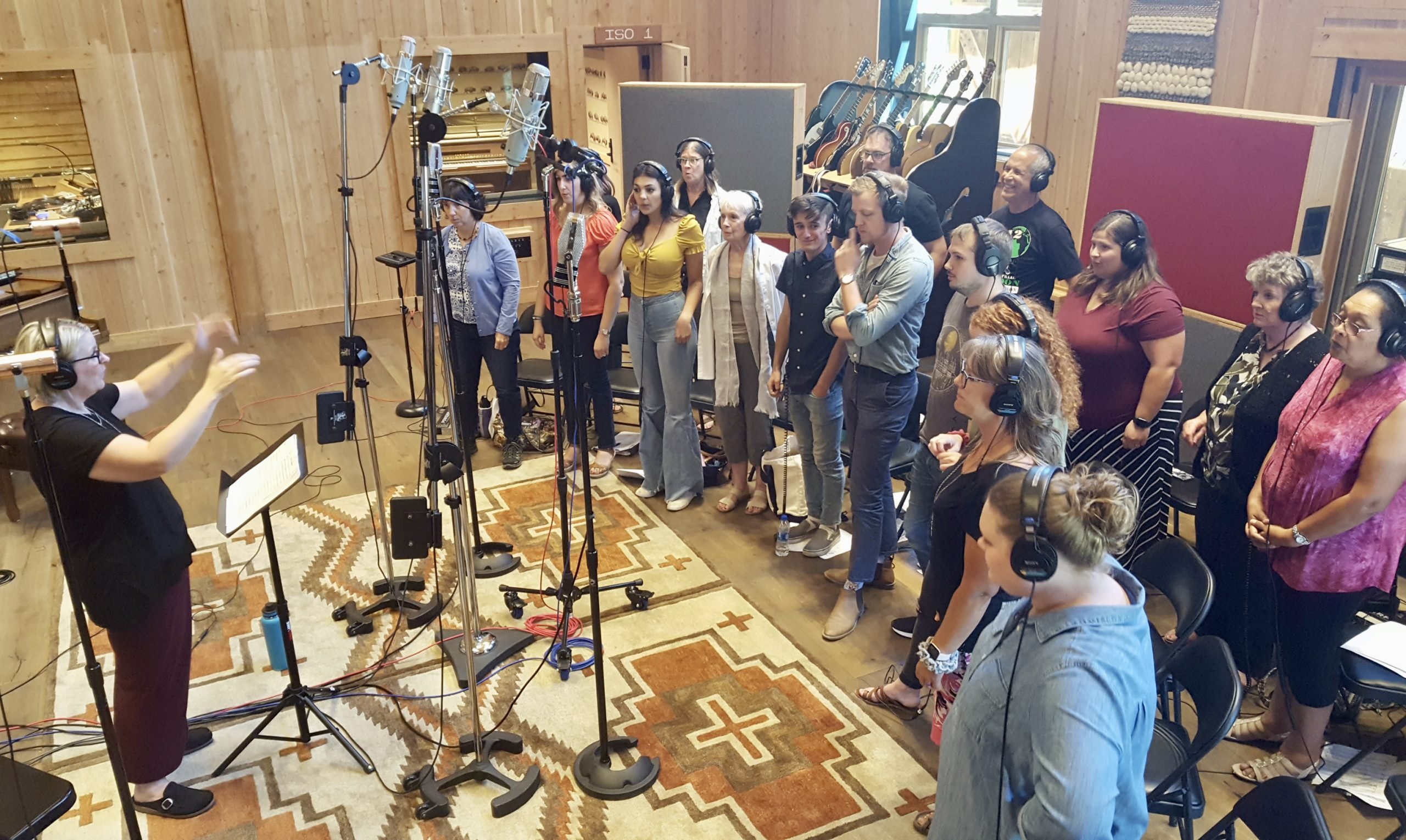 Director Mindy Wall ably leads the choir during the recording session.