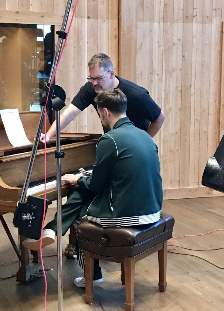 Ryan Lewis at the piano with LVV member Darryl Wall.